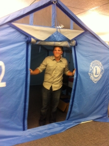 Joel inspecting tents used in Lions Disaster Relief efforts